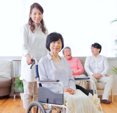 elderly people and caregivers in a facility