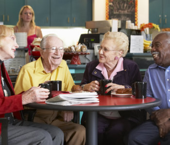 old people smiling to each other